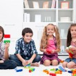 Children playing with blocks — Stock Photo #28162477