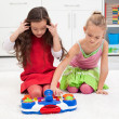 Little girls playing on the floor — Stock Photo