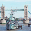 Stock Photo: Tower Bridge and warship HMS Belfast.