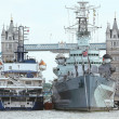 Stock Photo: Two big ships and Tower Bridge.