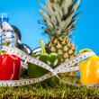 Stock Photo: Fitness theme with fruits, bright background
