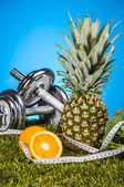 Fitness theme with fruits and vegetables — Stock Photo