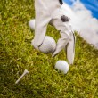 Golf equipment on green grass, golf field — Stock Photo