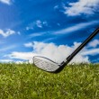Green field with golf equipment — Stock Photo