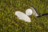 Golf game equipment on grass — Stock Photo