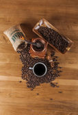 Coffee theme with wooden table and dark background — Stock Photo