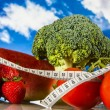 Healthy food, fitness concept on blue sky background — Stock Photo