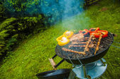Fire and grilling theme with grilled food — Stock Photo