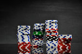 Gambling game on black background — Stock Photo