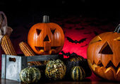 Dark composition of halloween pumpkins — Stock Photo