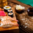Stock Photo: Wonderful sushi set, oriental theme on old wooden table