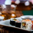 Stock Photo: Japanese sushi on old wooden table