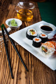 Japanese sushi on the old wooden table — Stock Photo