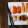 Decorative composition with sushi, Japanese seafood — Stock Photo #41600789