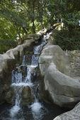 Waterfall on Mount Gurugu in the Maria Luisa Park — Stock Photo