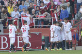 Sevilla's players celebrate their second goal — Stock Photo