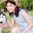 Stock Photo: Portrait women outdoor with siberihusky