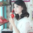 Stock Photo: Potrait women with red rotary telephone