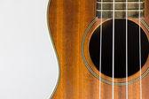 Brązowy ukulele części na białym tle — Zdjęcie stockowe