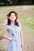 Portrait of women posing wearing hat outdoor green in park — Foto Stock