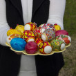 Stock Photo: Easter eggs in hands of