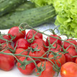 Cherry tomatoes cucumber salad on the tablecloth — Foto Stock