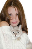 Beautiful girl with a cat. — Stock Photo
