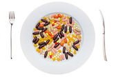 Plate with food supplements pills — Stock Photo