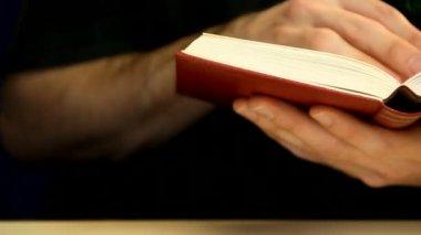 Reading a book — Стоковое видео