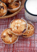 Muffins with almonds and cherries and milk — Stock Photo