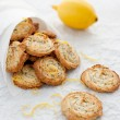 Lemon poppy seed cookies in paper bags on white background — Stock Photo
