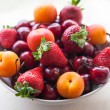 Assorted colorful fresh summer berries and fruits - apricots, ch — Stock Photo