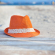 Orange hat on the beach — Stock Photo
