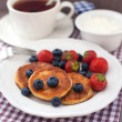 Cheese pancakes with fresh berries — Stock Photo #29604917