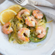 Zucchini noodles with prawns and lemon zest — Stock Photo #30830399