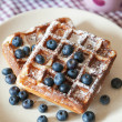 Breakfast with belgian waffles and fresh blueberry — Stock Photo