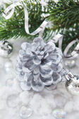 Silver Christmas decoration - cone candle, balls and branch of c — Stock Photo