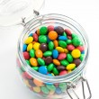 Colored candy in a glass jar — Stock Photo