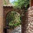 Wrought iron gate on the narrow street — Foto de Stock