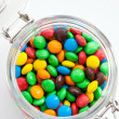 Colored candy in a glass jar — Stock Photo #32946973