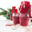 Two glasses of mulled wine and candle with Christmas decorations — Stock Photo
