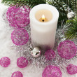 White candle and Christmas decorations around — Stock Photo