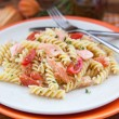 Fusilli pasta with smoked salmon and tomatoes  — Stock Photo