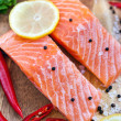 Raw salmon with lemon and pepper — Stock Photo