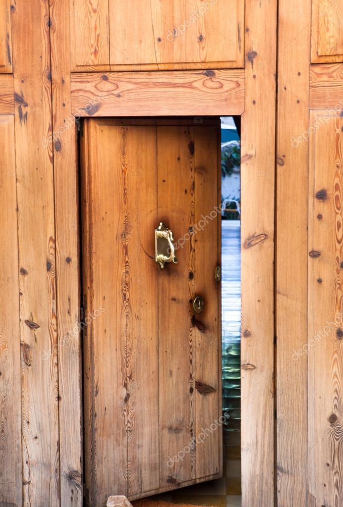 Ancient wooden door — Stock Photo © Kate_Smirnova #34598455