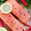 Raw salmon with lemon and pepper — Stock Photo #34832823