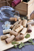 Wine corks on the table with glass and bottle on the background — Foto Stock