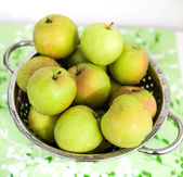 Fresh green apples in a colander — Foto Stock
