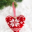 Knitted heart on the snow — Stock Photo