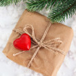 Gift box decorated with red heart — Stock Photo